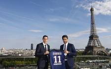 Angel Di Maria stands with Paris St. Germain President Nasser Al-Khelaifi after signing for the French club in August 2015. Picture: PSG/Twitter