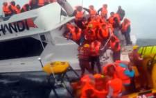 FILE: Screengrab of crew members and passengers rescued from a sinking Robben Island ferry. Picture: EWN.
