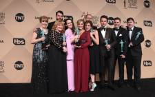 The cast of 'Downton Abbey' pose with the actor for outstanding performance by an ensemble in a drama series room at the 22nd Annual Screen Actors Guild Awards in January 2016. Picture: AFP.