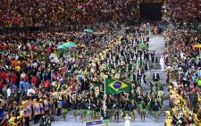 Brazil's Yane Marques leads her delegation during the opening ceremony of the Rio 2016 Olympic Games at the Maracana stadium in Rio de Janeiro on 5 August, 2016. Picture: AFP.