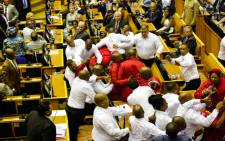 FILE: Security officials remove EFF members from the National Assembly after they disrupted President Zuma's 2017 State of the Nation Address. Picture: AFP.