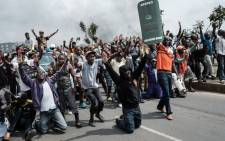Supporters of Kenyan's opposition party National Super Alliance (NASA) react when confronted by Kenyan police. Picture: AFP