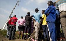 Residents of the Jerusalem informal settlement near Boksburg stand by a disused mine while emergency services continue rescue operations to find five-year-old Richard Thole who fell into the mine on 25 February 2017. Picture: Reinart Toerien/EWN