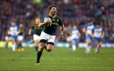 FILE: South Africa's Willie le Roux runs to score a try during the international rugby union test match between Scotland and South Africa at Murrayfield Stadium in Edinburgh, Scotland, on November 17, 2013. Source: AFP.
