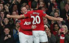 Manchester United's Robin Van Persie celebrates with team mate Wayne Rooney after scoring against Arsenal on 10 November 2013. Picture: Manchester United FC official Facebook page.