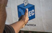 FILE: A Mamelodi resident holds out his thumb outside the Balebogeng Primary School after voting in the 2016 local government elections. Picture: Reinart Toerien/EWN