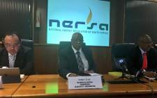 Nersa's Chairperson of the electricity subcommittee Mbulelo Ncetezo (C) addressing the media in Pretoria. Picture: Katleho Sekhotho/EWN.