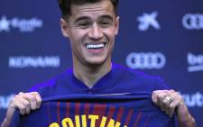 Barcelona's new Brazilian midfielder Philippe Coutinho shows his new jersey before holding a press conference in Barcelona on 8 January 2018. Picture: AFP.
