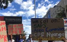 Learners holding placards outside the Western Cape Legislature demanding better safety measures. Picture: @equal_education/Twitter