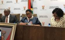 FILE: Telecommunications and Postal Services Minister Siyabonga Cwele (left) and Social Development Minister Bathabile Dlamini (centre) at a media briefing. Picture: EWN.