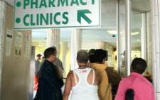 Patients queuing outside a hospital pharmacy