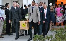 Close friends and family of James Thomas, the 57-year-old Cape Town man killed in the attack on the Westgate mall in Kenya, carry his coffin after the funeral service on 2 October 2013. Picture: Aletta Gardner/EWN