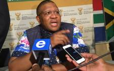 Sports and Recreation Minister Fikile Mbalula speaks to the media at Sascoc House. Picture: EWN.