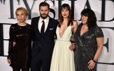 British director Sam Taylor-Johnson (L), British actor Jamie Dornan (2nd L), US actress Dakota Johnson (2nd R) and British author E.L James (R) pose for photographers ahead of the UK Premiere of 'Fifty Shades of Grey' in central London on 12 February, 2015. Picture: AFP
