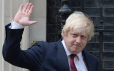 FILE: British Foreign Secretary Boris Johnson waves as he leaves 10 Downing Street in central London after British Prime Minister Theresa May took office. Picture: AFP.