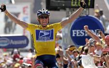 FILE: US rider Lance Armstrong (US Postal/USA) celebrate as he crosses the finish line and wins the 17th stage of the 91st Tour de France cycling race between Bourg-d'Oisans and Le Grand Bornand. Picture: AFP