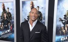 Dwayne 'The Rock' Johnson arrives at the Premiere of 'G.I. Joe: Retaliation' at TCL Chinese Theatre on 28 March 2013. Picture: AFP.