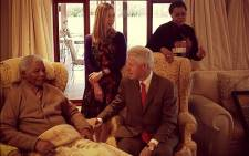 Former US President Bill Clinton and his daughter Chelsea meet Nelson Mandela and his wife Graca Machel in Qunu. Picture: Mbuso Mandela via Twitter