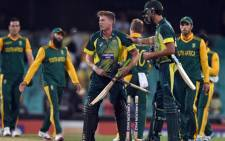 Australia's batsman James Faulkner (C) celebrates his teams victory against South Africa during their fifth one-day international cricket match at the Sydney Cricket Ground in Sydney on November 23, 2014. Picture: AFP.