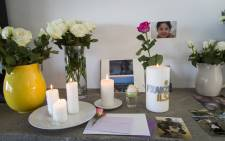 FILE: Photographs of Franziska Blchliger at various ages displayed alongside candles and flowers in the family's Cape Town home on 8 March 2016. Picture: EWN.