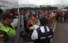 Venezuelan citizens cross the Simon Bolivar international bridge from San Antonio del Tachira in Venezuela to Norte de Santander province of Colombia on 10 February, 2018. Picture: AFP