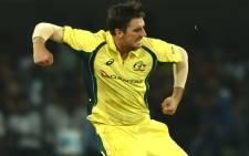 Australia fast bowler Pat Cummins celebrates taking a wicket. Picture: AFP