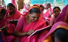 This photo taken on 1 March 2017 shows Indian grandmother Savita Deshmukh (C), 62, during class at the Aajibaichi Shala, or 'school for grannies' in the local Marathi language. Picture: AFP.