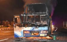This photo by Dailynews taken in the early hours of 30 March, 2018 shows the aftermath of a bus fire, in which at least 20 Myanmar migrant workers died, in the Thai western border province of Tak. Picture: AFP.