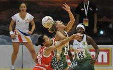 South Africa's Maryka Holtzhausen and Singapore's Qingyi Lin battle it out for the ball in the second pool match at the World Netball Champs on 05 July 2011. Picture: Supplied