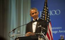 Former US president Barack Obama speaks to guests after receiving the 2017 John F. Kennedy Profile in Courage Award on 7 May, 2017 at the JFK Library in Boston, Massachusetts. Picture: AFP.