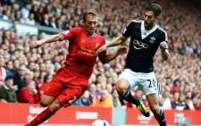FILE: Southampton's English midfielder Adam Lallana (R) competes with Liverpool's Brazilian midfielder Lucas Leiva (L) during the English Premier League football match between Liverpool and Southampton on September 21, 2013. Picture: AFP