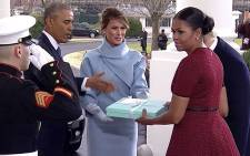 A screengrab of the gift exchange between Michelle Obama and Melania Trump. Picture: CNN