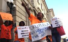 Members of the Sex Workers Education and Advocacy Taskforce (SWEAT) protest outside the Western Cape High Court where artist Zwelethu Mthethwa appeared on 10 November 2014. Picture: Aletta Harrison/EWN.