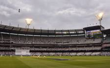 Australia take on England under rainy skies on the fourth day of the fourth Ashes Test match at the MCG in Melbourne on 29 December, 2017.  Picture: AFP