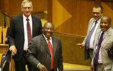 South Africa's new president Cyril Ramaphosa smiles alongside ANC chief-whip Jackson Mthembu (R) after being elected by the Members of Parliament in Cape Town, on 15 February 2018. Picture: Bertram Malgas/EWN