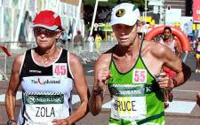 Zola Budd (L) and former nine time winner of the Men's Comrades Bruce Fordyce participate in the 89km Comrades Marathon on 3 June 2012. Picture: AFP