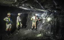 Miners at work in a shaft. Picture: AFP