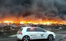 Firefighters battled a massive fire that broke out at a Durban warehouse on Friday, 24 March 2017. Picture: screengrab via @rescuecare
