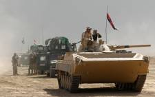 FILE: Iraqi forces hold a position on 17 October 2016 in the area of al-Shurah, some 45km south of Mosul, as they advance towards the city to retake it from the Islamic State group jihadists. Picture: AFP.