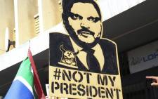 Many anti Zuma protesters carried placards addressing the President's alleged ties with the Gupta family. Picture: Cindy Archillies/EWN