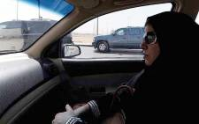 FILE: A Saudi woman sits in a vehicle as a passenger on 22 September 2013 in Riyadh. Picture: AFP.