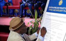 Police Minister Bheki Cele signs the ethics and integrity pledge at the launch of SAPS' anti-corruption strategy on 29 June 2018. Picture: @SAPoliceService/Twittter.