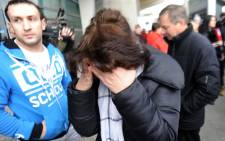 Relatives react at Pulkovo international airport outside Saint Petersburg after a Russian plane with 224 people on board crashed in a mountainous part of Egypt's Sinai Peninsula on 31 October, 2015. Picture: AFP.