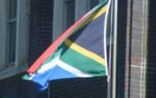 South African flags fly at half mast.