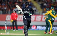 New Zealand's Martin Guptill is run out for 34 runs during the semi-final Cricket World Cup match between New Zealand and South Africa played at Eden Park in Auckland on 24 March, 2015. Picture: AFP.