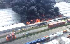 Firefighters battled a massive fire that broke out at a Durban warehouse on Friday, 24 March 2017. Picture: @vemaparamedics