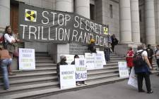 Protesters gathered outside of the Western Cape High Court where it was ruled that government's decision to call for proposals for the procurement of 9.6 gigawatts of nuclear energy is unlawful and unconstitutional. Picture: Cindy Archillies/EWN