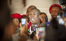 EFF leader Julius Malema addresses members of the media on the Parliamentary steps after the EFF was thrown out of the State of the Nation Address. Picture:Thomas Holder/EWN