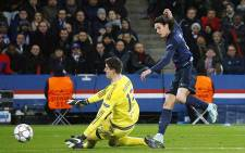PSG's Edinson Cavani slots the ball passed Chelsea FC goalkeeper Thibaut Courtois for a goal during the Uefa Champions League match on 17 February 2016. Picture: PSG/Facebook.