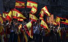 Protestors gather holding Spanish flags during a demonstration against independence of Catalonia called by DENAES foundation for the Spanish Nation Defence at Colon square in Madrid on October 07, 2017. Picture: AFP
